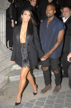 Hold on tight: All eyes were on the pair as they continued their week which could easily be titled 'Kim and Kanye take Paris Fashion Week'