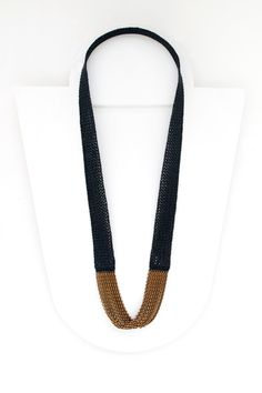 """""""Infinity"""" necklace by Emily Bixler, knitted silk/wool and brass chains. Gallery Lulo."""