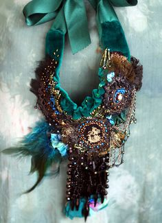Vert-- bold, rustic, tribal influenced necklace from vintage and antique textiles and trims