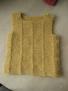Ravelry: Woollahoo's Baby vest with small cables and buttons
