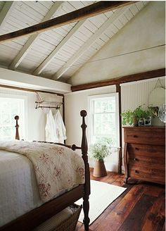 I love the combination of wood and white Master bedroom with not white but barn wood ceiling.
