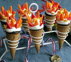 Olympic Torch Cupcakes ~ Unique torch cupcakes baked in sugar cones with candy clay to create the flame look.