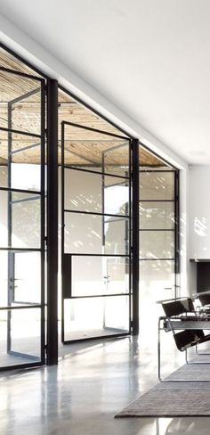 Dynamic large swinging glass framed doors - Home House Interior Decorating Design Dwell Furniture Decor Fashion Antique Vintage Modern Contemporary Art Loft Real Estate NYC Architecture Inspiration New York YYC YYCRE Calgary Eames Style At Home, Interior Architecture, Interior And Exterior, Rustic Exterior, Exterior Design, Steel Doors And Windows, Big Doors, Office Interiors, Modern Interiors