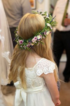 Flowergirl wears a wild flower styled floral crown| Photography by http://www.kimberleybrand.com/