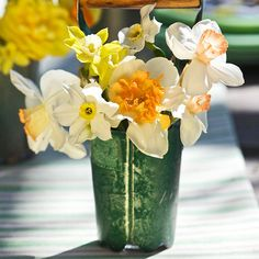 Blooms in a Bulb Planter  Bulb planters are great for getting your flowers in the ground, but they also make adorable flower containers for Mother's Day. Place a small container inside the planter; fill with water and a dozen stems of your mom's favorite blooms.