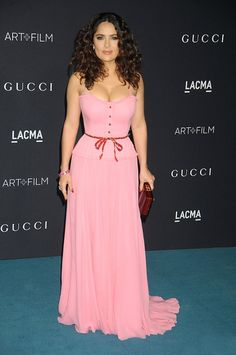 #FASHIONPASSPORT >>> FASHION PASSPORT TV - 2015 LACMA ART + FILM GALA SALMA HAYEK IN GUCCI Salma Hayek looks absolutely striking while walking the red carpet at the 2015 LACMA Art+Film Gala Honoring James Turrell and Alejandro G Iñárritu, Presented by Gucci on November 7, 2015 in Los Angeles. The actress donned a rose pink Gucci Spring 2016 gown. Styled her look with Gucci red shoes and a Gucci Burgundy clutch.
