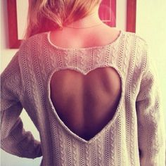 heart cut-out-on-back sweater. Pretty,cozy, and innocent.  Would be perfect with colored tanks underneath and tights and Uggs...