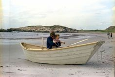 JFK and John, Jr. in a beached rowboat