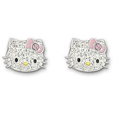 6c0bd9ca8 This cute pair of palladium-plated stud earrings features Hello Kitty's  face in sparkling clear crystal Pointiage®. She wears her signature bow in  red pink ...