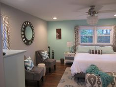 Love this color combo for master bedroom. Blue walls, grey accent behind bed. Possibly wit a design..