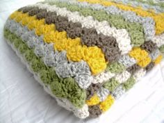 Crochet Baby Blanket in Neutral Colors, yellow, brown, grey, tan, and green, travel size