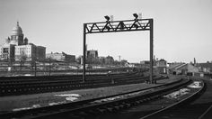 NH, Providence, Rhode Island, 1950-1955 New York, New Haven and Hartford train disappearing through signal bridge and safety switch no. 151 spanning tracks two and four at the Rhode Island State House, in Providence, Rhode Island, some time between 1950 and 1955. Photograph by Leo King, © 2016, Center for Railroad Photography and Art. King-01-014-001