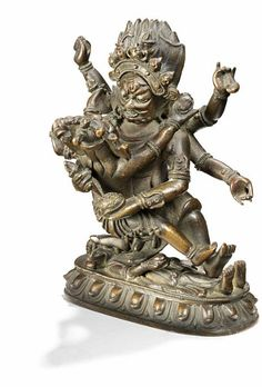 Lot : A Tibetan bronze figure of the wrathful deity Mahakala in union with his consort.[...] | Dans la vente Art d'Orient à Bruun Rasmussen Auctioneers