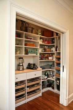love the idea of having a large closet to store small appliances and cookware