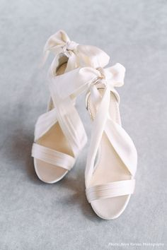 Criss Cross Ivory Silk and Bow Wedding Heel We simply can't get enough of Kate draped in lustrous silk ribbons. The ivory silk ribbons wrap around your feet in a criss cross pattern. Tie them at t Wedding Shoes Bride, Wedding Bows, Bride Shoes, Wedding Styles, White Wedding Shoes, Ivory Wedding, Wedding Shoes Heels, Wedding Makeup, Elegant Wedding