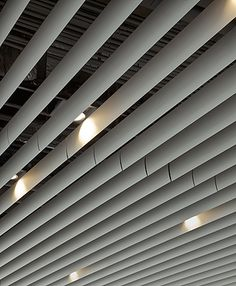 Hunter Douglas Baffle Ceiling Baffle Ceiling, Metal Ceiling, Ceiling Lights, Ceiling Detail, Ceiling Design, Wall Design, Wood Architecture, Architecture Details, Timber Battens