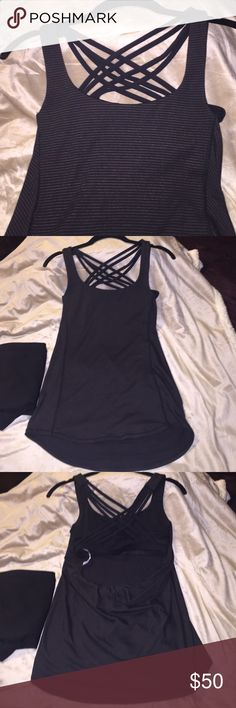 Lululemon tank blk & silver pin striped top Lululemon (authentic) drape top with built in bra. In new condition; tried on but never worn. Was a gift, fits my chest a bit tight: 32D-DD. I don't wanna give it up, but it needs a good home. 🚫NO TRADES🚫 ONLY REASONABLE OFFERS PLEASE. lululemon athletica Tops Tank Tops