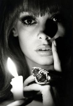 Jean Shrimpton by Bert Stern This is a casual and unique portrait as the way that she is posing isn't formal though the candle and the shadow makes it seem mysterious