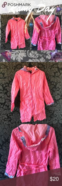 ☔️ Pink Portable Rain Coat Poncho ☔️ Light bright pink one layered poncho with a hood, zipper, waist tie (for a more styled and fitted fit), and pockets. Jacket has blue purple floral trim inside hood and on the fold of the sleeves. Comes with a pink pouch, so it can be folded up and carried around in the event of rain or weather. Also great for bringing to theme parks and water parks to wear on rides. Perfect for trips to South America and Europe. Purchased in Argentina, never before used…