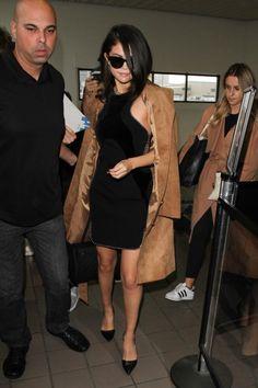 Selena Gomez wearing Celine Audrey Sunglasses, Louis Vuitton Trocadero Bag, Giuseppe Zanotti Geometric Cut Out Pumps, Alexander Wang Ball Chain Trim Wavy Velvet Panel Dress and H&M Coat in Imitation Suede Beige