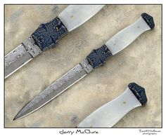 """White jade daggers by Jerry McClure.  The length of this dagger is 7 3/4"""", the blade is 5 1/4"""" made with Damasteel Odin's eye pattern. The handle scales are Siberian white jade, the bolsters are blued Radioactive pattern mosaic."""
