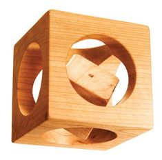 Cube in a Cube: Kids play with it like a toy, but it drives adults nuts. They think it's a puzzle. They're sure there's some way to get the little cube out of the big cube. You can't.