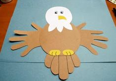 """The eagle portion of the Team Animal Mural will look similar to """"Handprint Bald Eagle Craft"""" featured on All Kids Network when completed. Depending on how many girls complete this part of the Journey, we will double-up on the hand prints for the wings and may even swap out the drawn tail for a hand print one."""