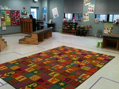 This is music classroom heaven. Look at all that space and equipment! I like the way it is zoned into activity spaces.