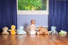 A little boy just hanging out with his stuffed animals.  Baby Photography