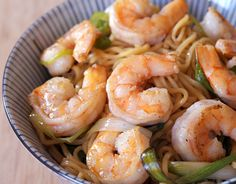 Shrimp Lo Mein     10 ounces fresh lo mein noodles, or dry Chinese egg noodles     2 tablespoons sesame oil     1 tablespoon peanut or vegetable oil     1 pound shrimp, peeled and deveined     1/2 tablespoon minced garlic     1 teaspoon minced or grated ginger     4scallions, shredded