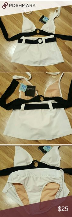 Beautiful Black and white swim suit Brand new with tags top   brand new without tags bottom. Newport news swimsuit. Halter top with ties around back and neck with bra cups..bottom has a little skirt over bikini bottom attached. And a wide belt so flattering.  Size 6 top..size 4 bottom.. Newport News Swim Bikinis