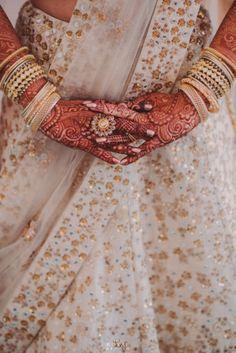 Wedding Ideas & Inspiration | Indian Wedding PhotosStunning white and gold lehenga with gold and kundan jewellery | WedMeGood| #wedmegood #indianweddings #kundan #gold #white #lehenga #bridal #bridallehenga