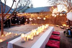 so many fantastic elements: string lights, chinese paper lanterns, white candles, burlap