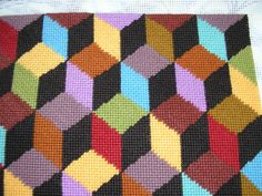 """Kaffe Fasset """"Tumbling Blocks"""" worked on 10 hpi canvas in 2005."""