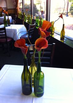 Find great inspiration for easy and beautiful DIY calla lily centerpieces, with photos and how-to videos Calla Lily Centerpieces, Wine Bottle Centerpieces, Wedding Centerpieces, Wine Bottles, Beer Bottle, Wedding Arrangements, Table Arrangements, Flower Arrangements, Seating Plan Wedding