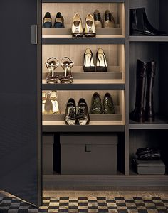 Senzafine New Entry wardrobe with moka glossy lacquered doors. Shoestand inclined shelves in cenere oak melamine with piombo painted aluminium frame and built-in led lamps. Boxes covered in fabric.