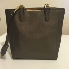 Coach golden brown crossbody. Gently used Adorable small crossbody from Coach. Removable long strap. No pen marks. Very clean! Gold hardware. Coach Bags Crossbody Bags