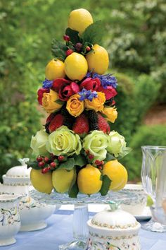 Fruit & flower topiary on glass cake stand. Gorgeous! Floral Centerpieces, Table Centerpieces, Decoration Table, Wedding Centerpieces, Wedding Decorations, Fruit Centerpiece Ideas, Fruit Arrangements, Flower Arrangement, Glass Cakes