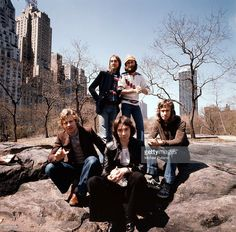Drummer Bill Bruford, bassist Mike Rutherford, guitarist Steve Hackett, singer Phil Collins and keyboard player Tony Banks in Central Park, New York City in April 1976.