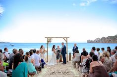 Wooden Arch, rustic wooden benches Ceremony @ Hacienda Cocina and Cantina by www.momentosweddingsloscabos.com Photo by www.gabrielamohar.com