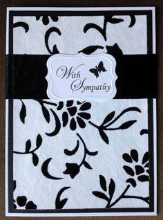 Black and white floral sympathy card on black flocked paper.