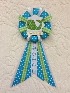 A personal favorite from my Etsy shop https://www.etsy.com/listing/510491648/mommy-to-be-ribbon-corsage-for-baby