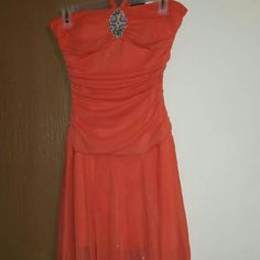 Cute orange prom dress This is a sparkly orange prom/homecoming dress. Worn once, great condition. Stretchy and comfortable. It does have a halter top with the straps right above the jewel at the top in the middle. 100% Polyester lining Discounted bundles 20% off 3+ items I do take reasonable offers  Taboo Dresses Prom