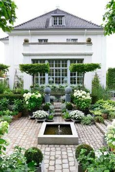 """""""Sunken Garden"""" is straight out of a fairytale 😍 We love how abstract all of the different plants are, such as those like the umbrella-formed trees called Carpinus betulus. Share your flourishing garden with us using Formal Gardens, Outdoor Gardens, Courtyard Gardens, Sunken Garden, Garden Types, Garden Cottage, White Gardens, Garden Spaces, Back Gardens"""