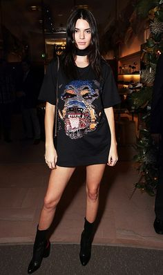 Kendall Jenner is edgy in a Givenchy T-Shirt, black bag, and Givenchy leather boots