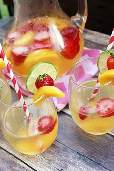 Strawberry Peach White Wine Sangria - This is the perfect way to cool off on a hot summer day and perfect for any type of entertaining or parties!