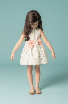 Gold spotty party dress with bow detail at Hucklebones girlswear for spring 2015