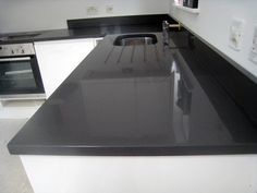 dark grey quartz counters with little variation -- it would go perfectly with the marble subway tile back splash!