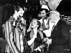 James Stewart, Cornel Wilde and director Cecil B. DeMille welcome Helen Hayes to the set of The Greatest Show on Earth