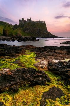 everything-celtic:  Sunset at Dunluce Castle, County Antrim, Northern Ireland (by Joe Daniel Price)